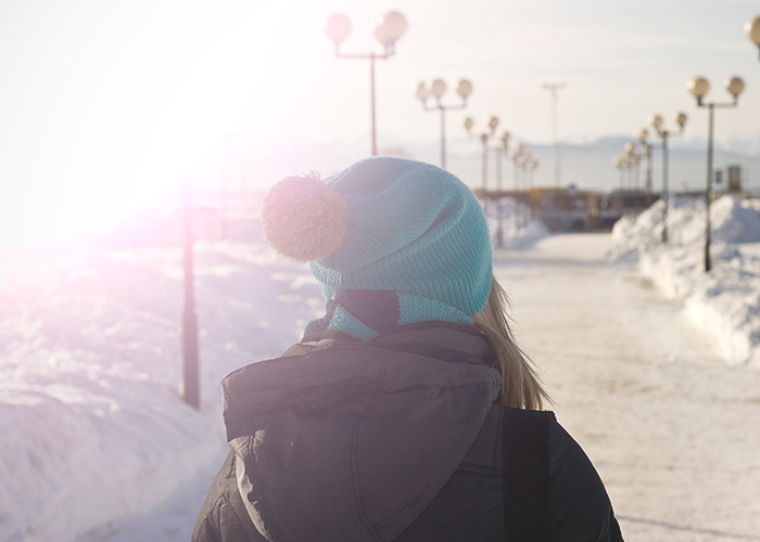 tfd_photo_woman-walking-in-snow-blue-hat