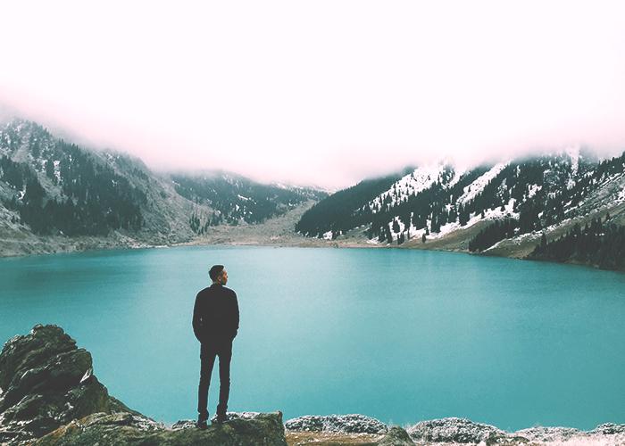 man-standing-near-lake