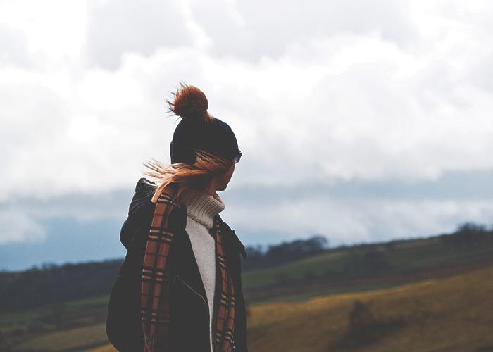 tfd_woman-wearing-cozy-hat-in-field