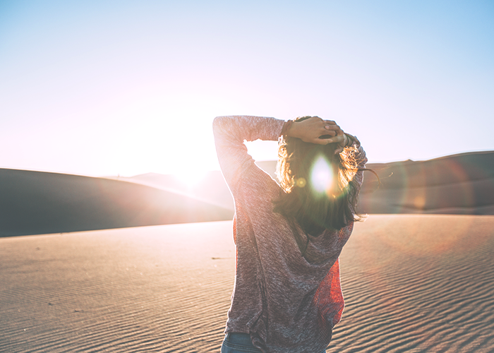 woman-standing-in-sun
