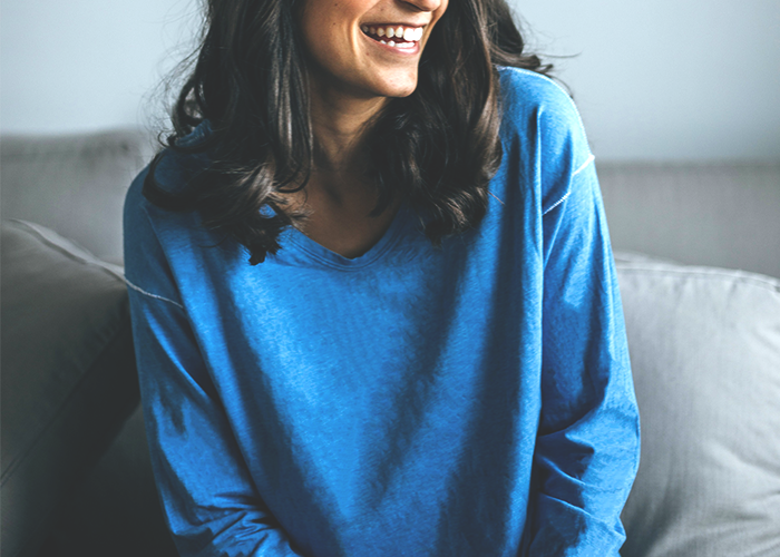 tfd_young-woman-blue-sweater-laughing