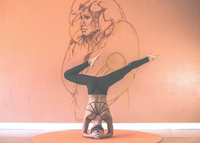 tfd_woman-in-studio-practicing-yoga