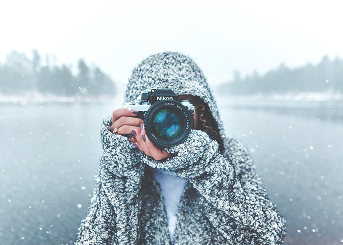 tfd_woman-taking-photo-covered-in-snow