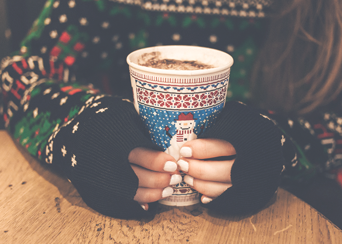 womans-hands-on-mug-of-hot-chocolate