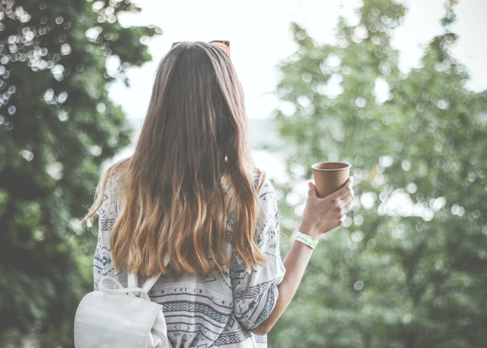 tfd_woman-standing-with-coffee-cup