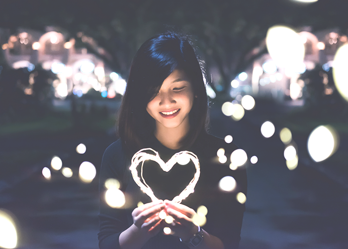 woman-holding-a-light-heart